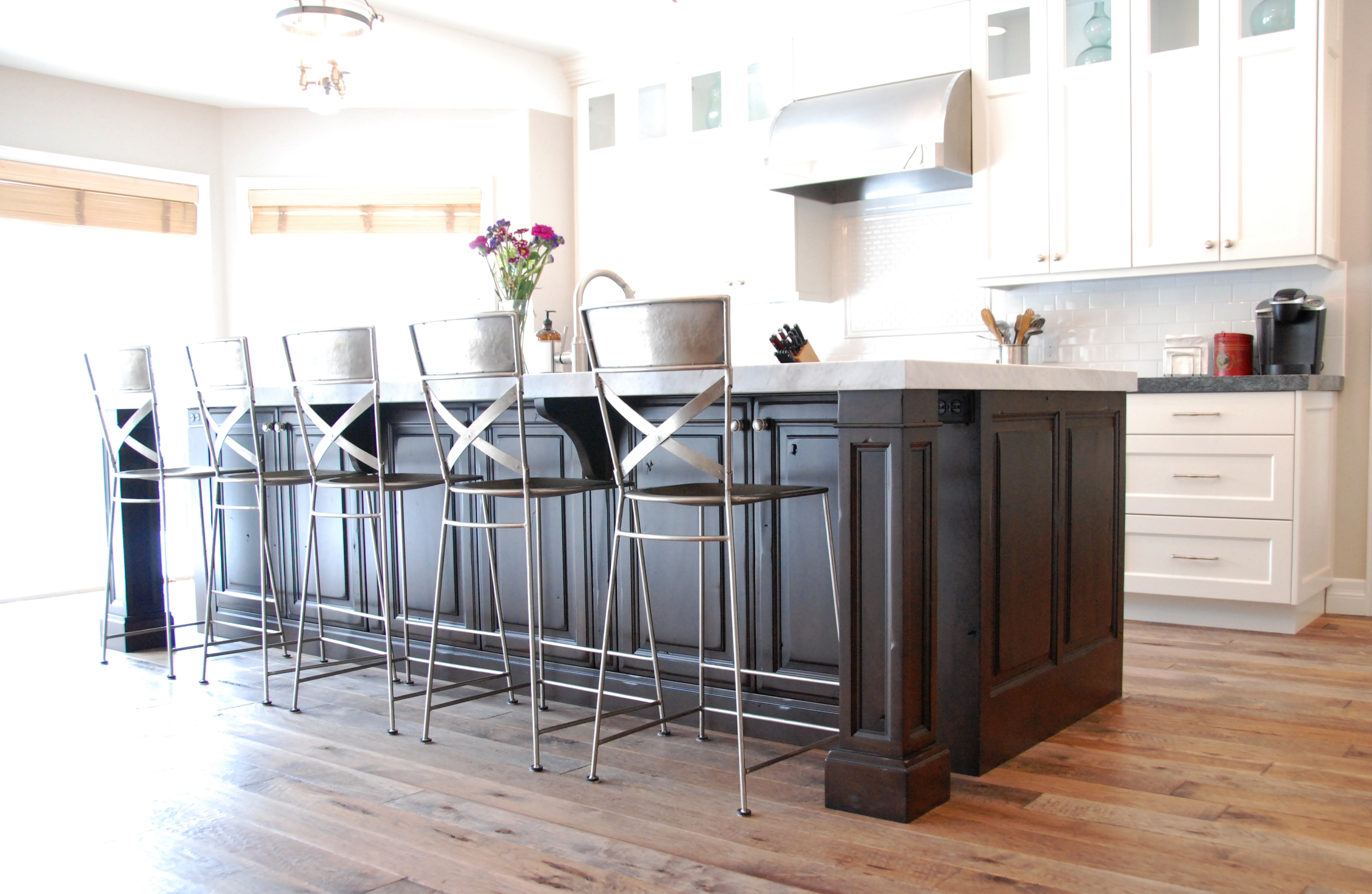 A Transitional White Kitchen With Dark Cherry Wood